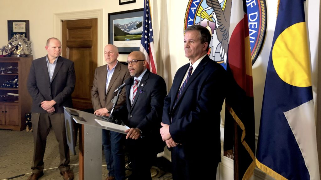 Mayor Michael Hancock, flanked by Bob McDonald, the director of Denver Department of Public Health and Environment on his right. March 2, 2020. (David Sachs/Denverite)