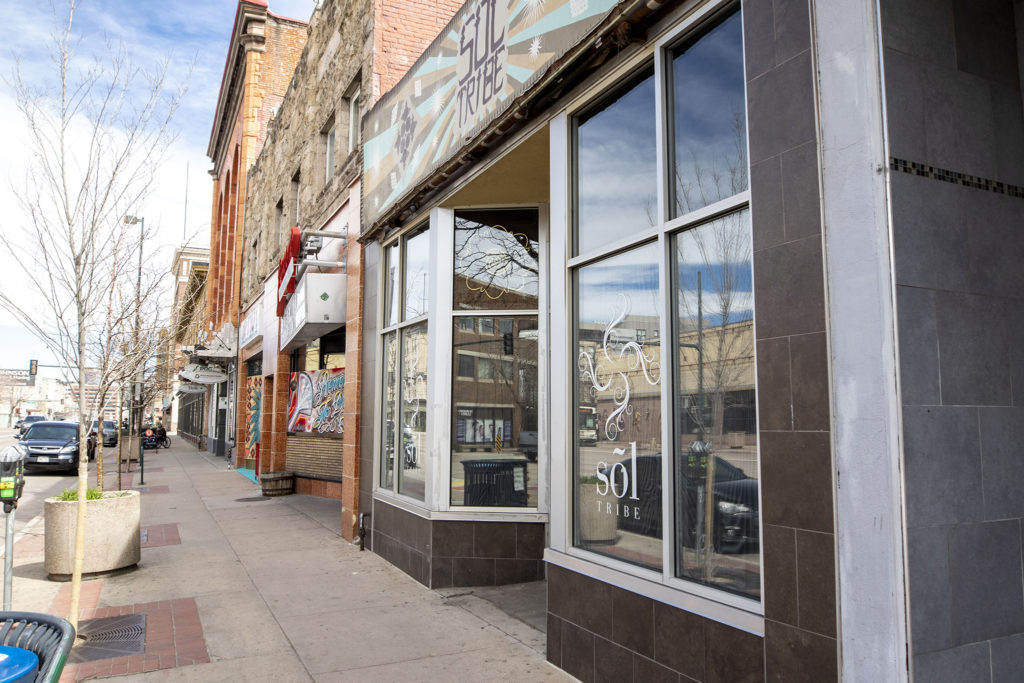 Sol Tribe Tattoo and Piercing on Broadway is boarded up from the inside. April 1, 2020. (Kevin J. Beaty/Denverite)