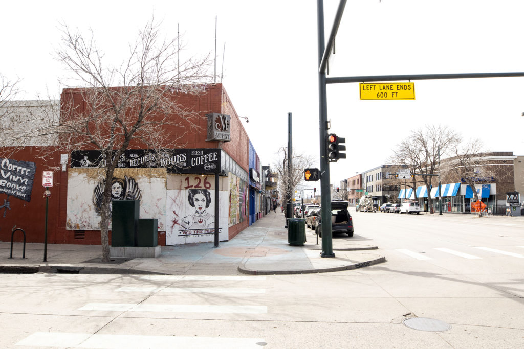 Mutiny Information Cafe is boarded up and covered with paint on Broadway. April 1, 2020. (Kevin J. Beaty/Denverite)