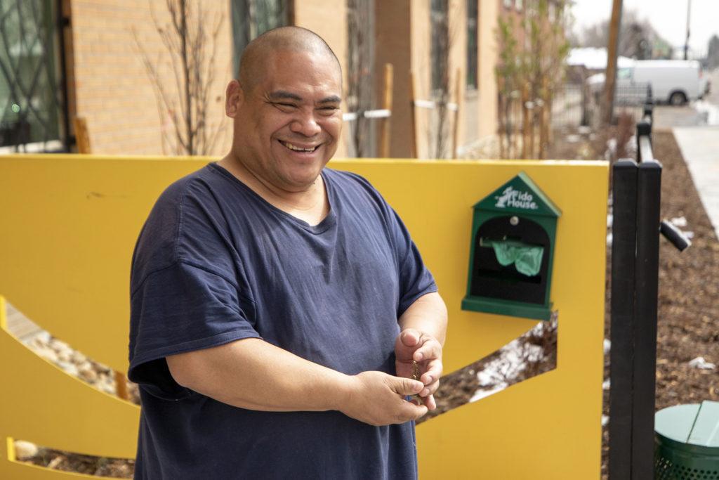 A man named Juan gets a box of food from the Mental Health Center of Denver. April 3, 2020. (Kevin J. Beaty/Denverite)