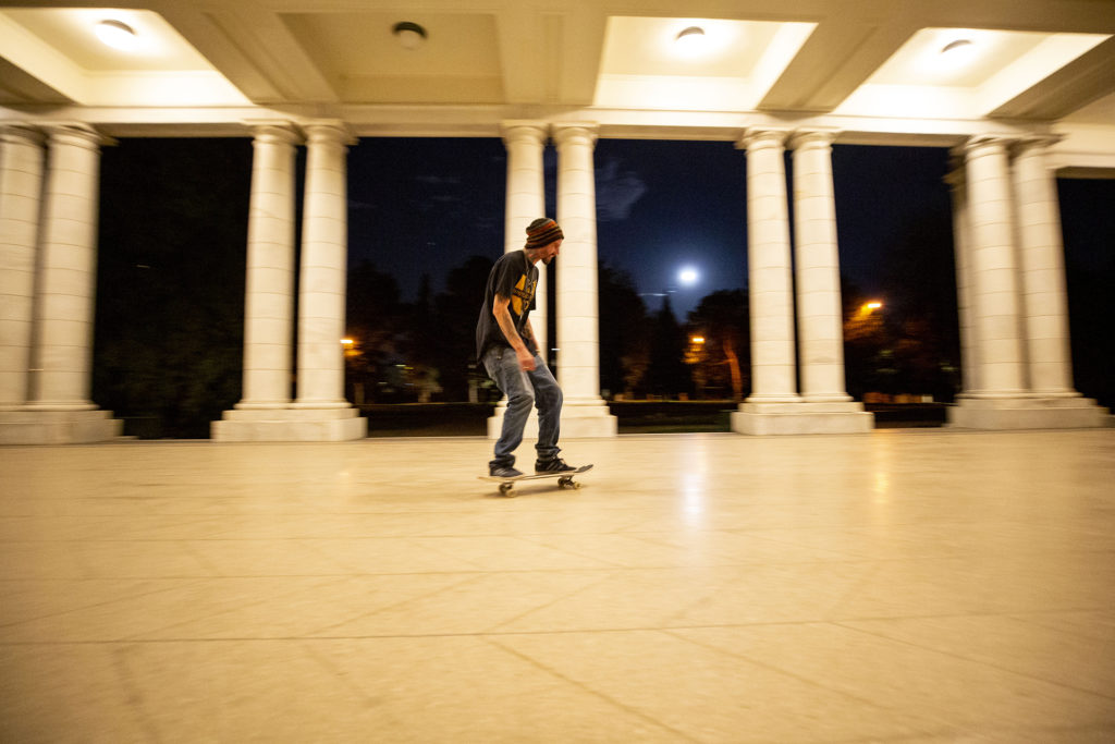 Travis Dunning skates in the Cheesman Park colonnade. April 7, 2020. (Kevin J. Beaty/Denverite)
