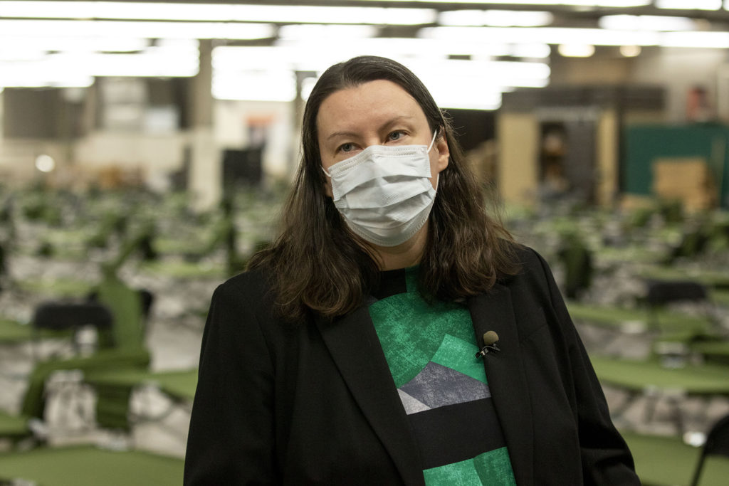 Britta Fisher, executive director of Denver's Department of Housing Stability, gives a tour of a men's shelter being constructed at the National Western Center. April 8, 2020. (Kevin J. Beaty/Denverite)