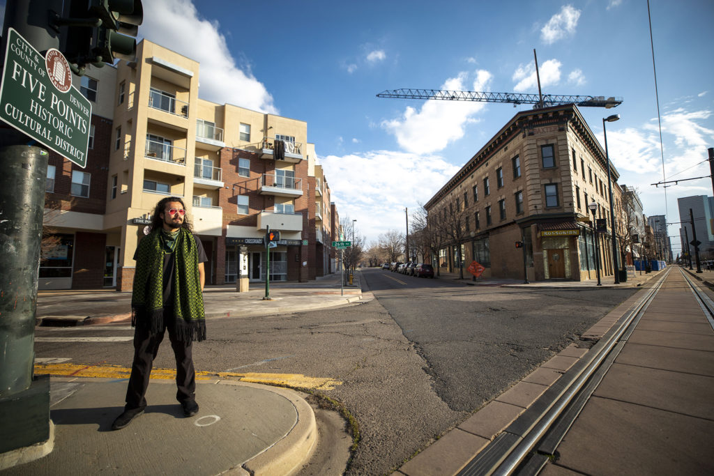 Ryan Foo poses in Five Points by the shuttered Crossroads Theater where the Black Actors Guild once held court. April 9, 2020. (Kevin J. Beaty/Denverite)