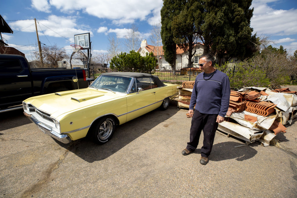 James Sharpless stands with his 1968 Doge Dart convertable, which he's selling on Craigslist. April 9, 2020. (Kevin J. Beaty/Denverite)
