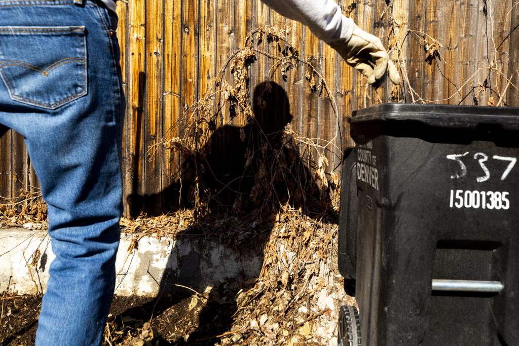 Steve Nissen cleans an alleyway near 5th Avenue and Emerson Street. April 9, 2020. (Kevin J. Beaty/Denverite)