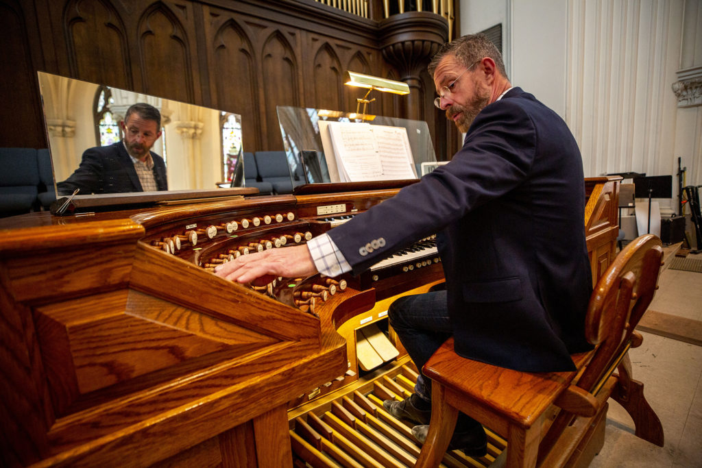 Phil Bordeleau, director of sacred music at the Cathedral Basilica of the Immaculate Conception, plays the organ during Easter mass. April 12, 2020. (Kevin J. Beaty/Denverite)
