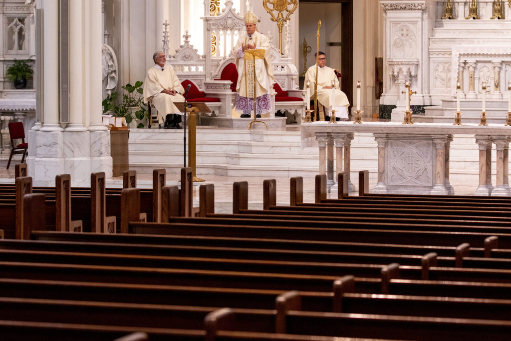 Archbishop Samuel Joseph Aquila leads Easter mass at the Cathedral Basilica of the Immaculate Conception. April 12, 2020. (Kevin J. Beaty/Denverite)