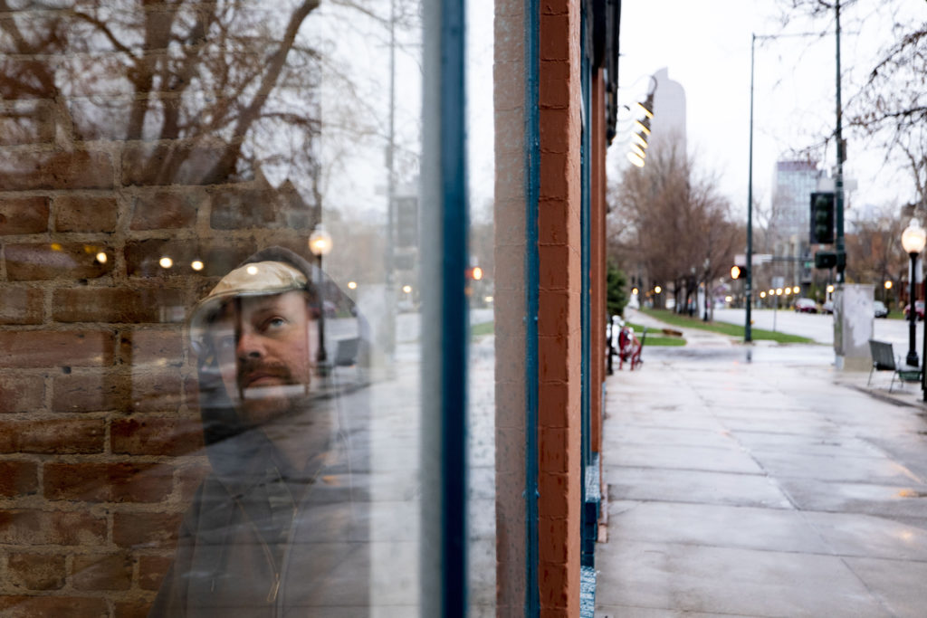 Artist Jared D.P. Anderson  sketches installation plans at the Leon Gallery in City Park West space. April 15, 2020. (Kevin J. Beaty/Denverite)