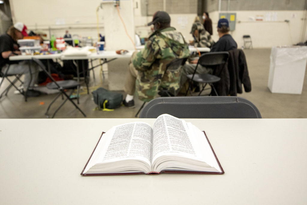 A Bible sits on a table at the National Western Center, which is now a shelter for people living in homelessness. April 15, 2020. (Kevin J. Beaty/Denverite)