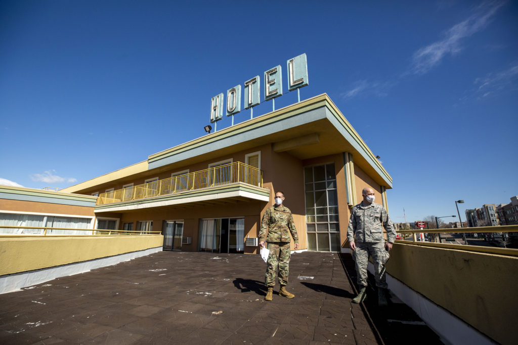 Colorado National Guardsmen Airman First Class John Boyle (right) and Staff Seargent Bart Blumberg map out the Rodeway Inn on Zuni Street as it's transformed into housing for people living in homelessness. April 15, 2020. (Kevin J. Beaty/Denverite)