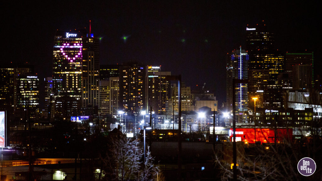 The Optiv building at 15th and Arapahoe Streets is lit up with a pink heart. April 3, 2020. (Kevin J. Beaty/Denverite)