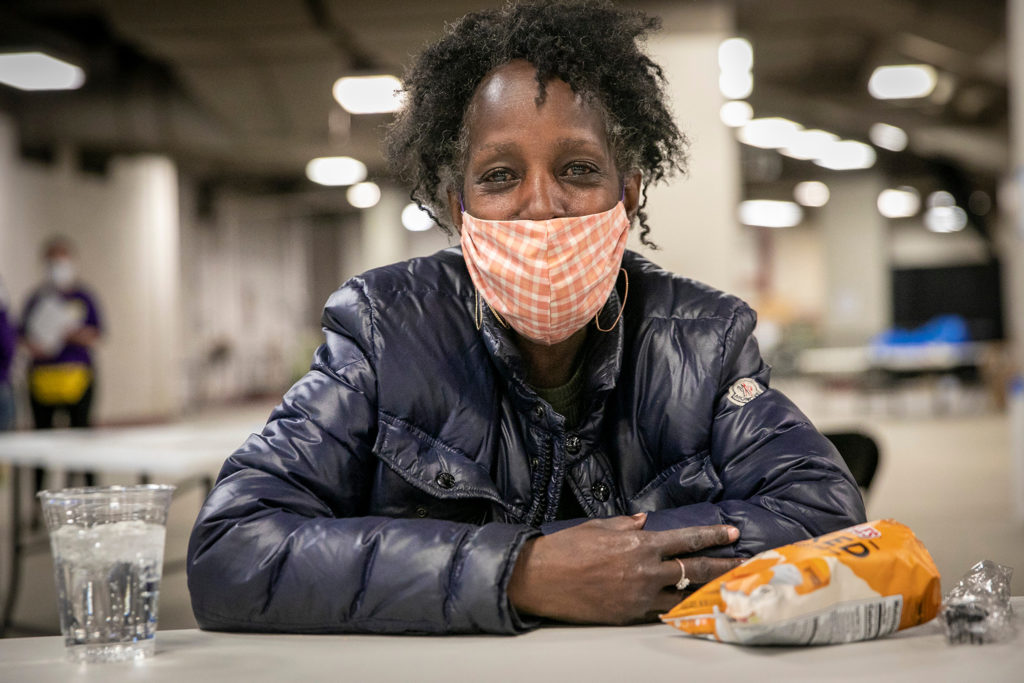 Denver is now operating two auxiliary shelters for the homeless, one for men at the National Western Complex, and one pictured here for women at the Coliseum. Jeanetta Simmons is staying at the new facility, having come over from the Samaritan House shelter. (Hart Van Denburg/CPR News)