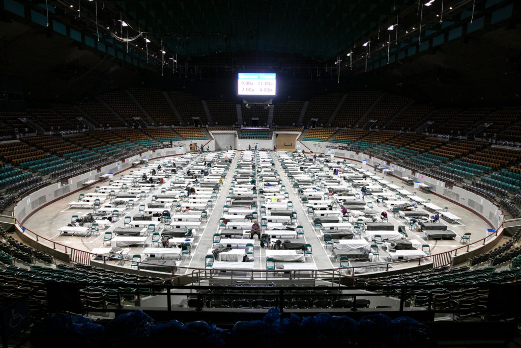 Denver is now operating two auxiliary shelters for the homeless, one for men at the National Western Complex, and one pictured here for women at the Coliseum. The facilities offer respite, screening for coronavirus, and sleeping areas that adhere to social distancing rules. (Hart Van Denburg/CPR News)