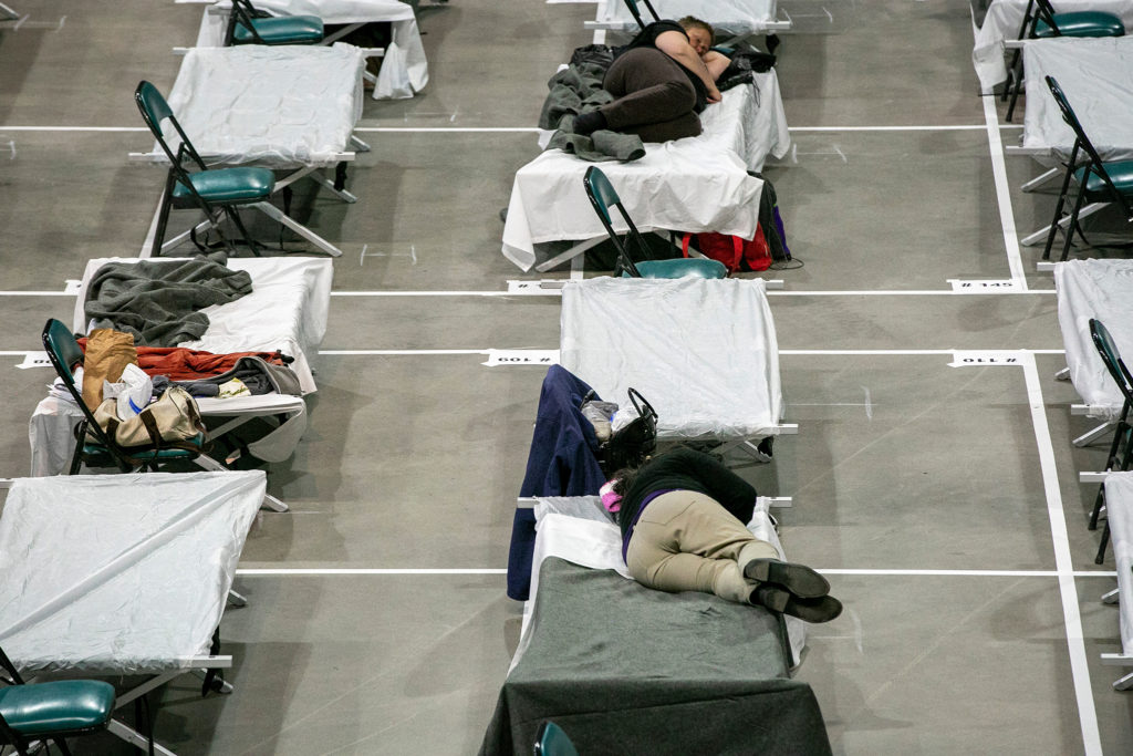 Denver is now operating two auxiliary shelters for people experiencing  homelessness, one for men at the National Western Complex, and one pictured here for women at the Coliseum. The facilities offer respite, screening for coronavirus, and sleeping areas that adhere to social distancing rules. (Hart Van Denburg/CPR News)