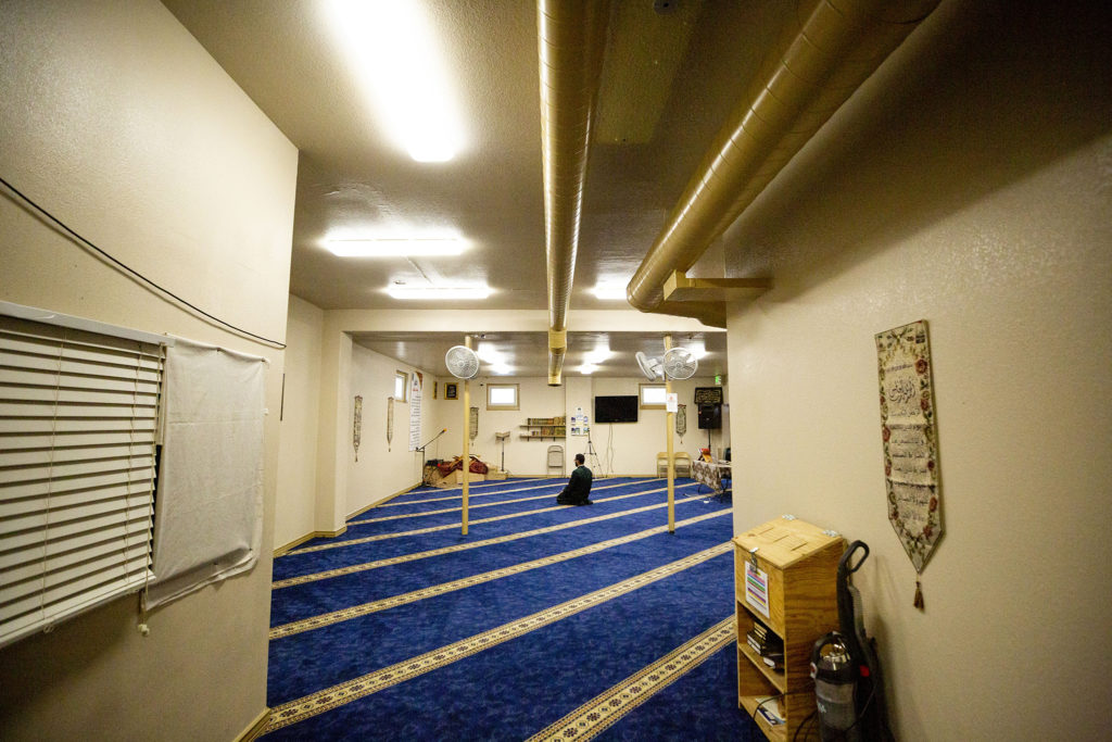 Imam Muhammad Kolila prays alone at the Downtown Denver Islamic Center as the first day of Ramadan comes to a close. April 24, 2020. (Kevin J. Beaty/Denverite)