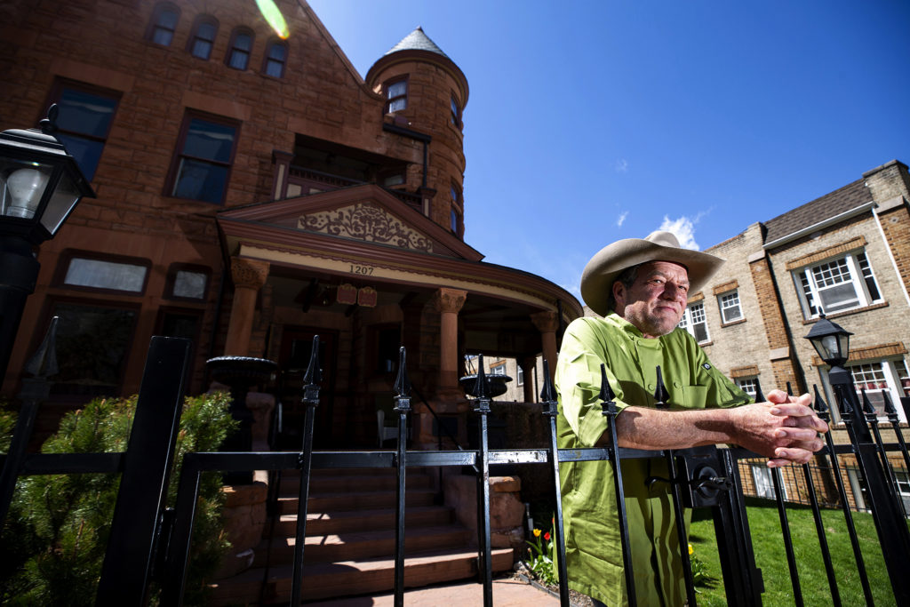 Carl Schmidt, proprieter of the Capitol Hill Mansion Bed and Breakfast, stands in his front lawn. April 25, 2020. (Kevin J. Beaty/Denverite)