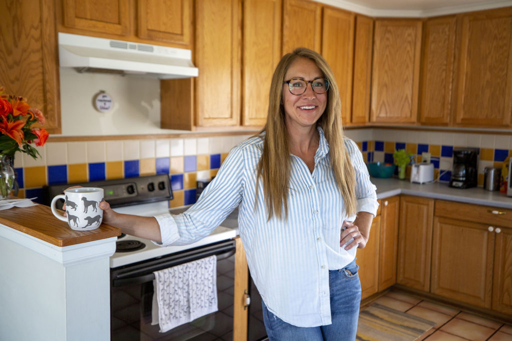 Natalie Toth, the Denver Museum of Nature and Science's chief fossil preparator, stands in her kitchen where she's also been working on fossils. April 27, 2020. (Kevin J. Beaty/Denverite)