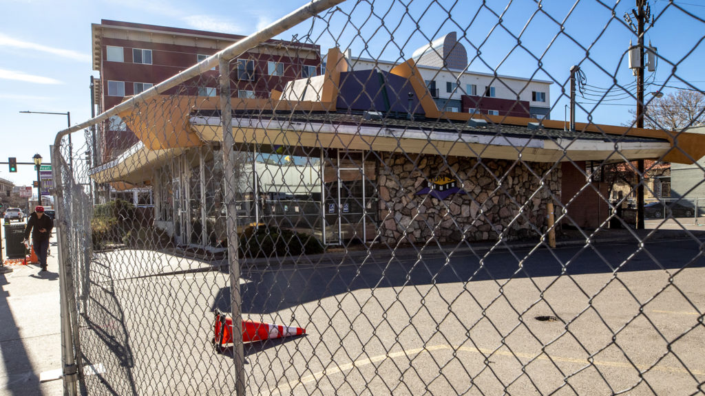Tom's Diner has a fence around it. North Capitol Hill, April 29, 2020. (Kevin J. Beaty/Denverite)