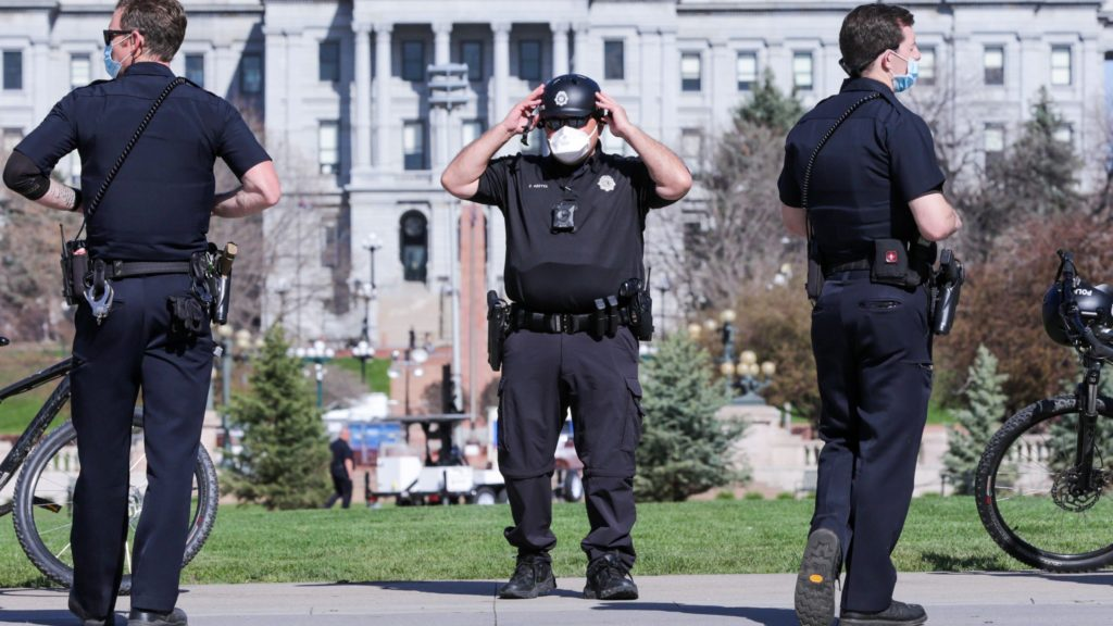 Denver Police officers on duty April 20 in Civic Center Park, standing where in recent years crowds filled the park to celebrate all things weed on 4/20. (Hart Van Denburg/CPR News)