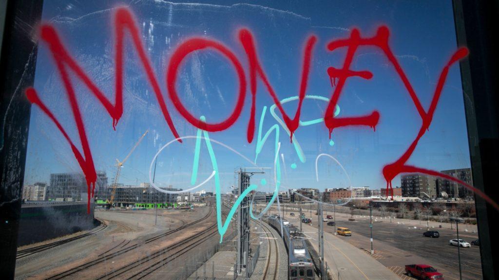 RTD commuter rail trains in downtown Denver. (Hart Van Denburg/CPR News)