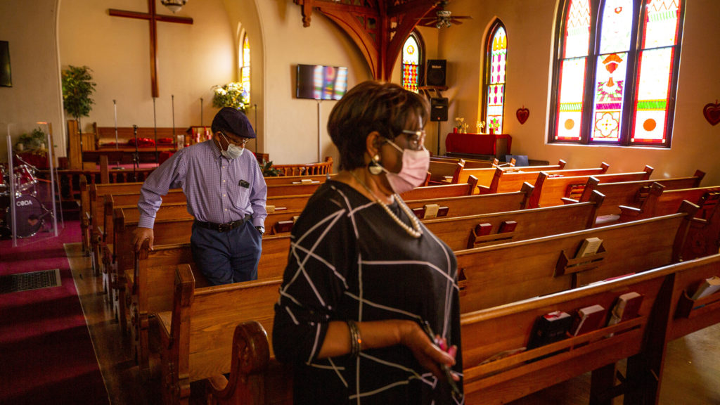 Robert and Eddie Woolfolk stand inside the Agape Christian Church in Five Points. May 1, 2020. (Kevin J. Beaty/Denverite)