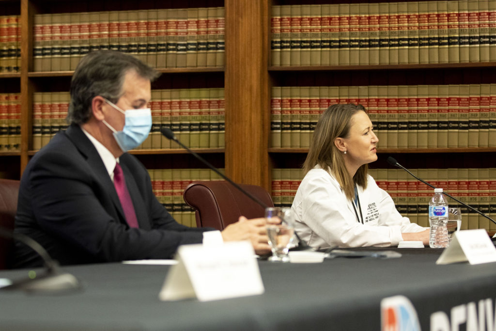 Dr. Connie Price, Denver Health's chief medical officer, and Bob McDonald, executive director of Denver's Department of Public Health and Environment, speak during a COVID-19 update in the City and County Building's Parr-Widener Room. May 5, 2020. (Kevin J. Beaty/Denverite)