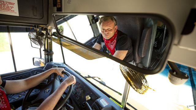 DPS bus driver Jack Rutten helms a mobile food pantry parked outside of Schmitt Elementary School in Ruby Hill. May 6, 2020. (Kevin J. Beaty/Denverite)