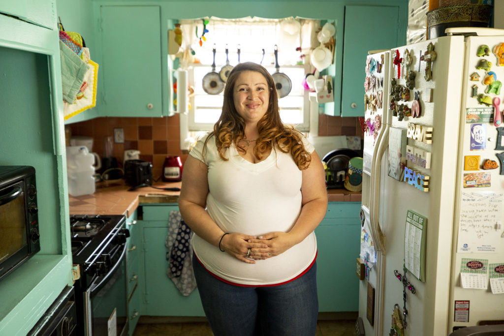 Liz Dikeman stands in her kitchen at home in Commerce City. May 6, 2020. (Kevin J. Beaty/Denverite)