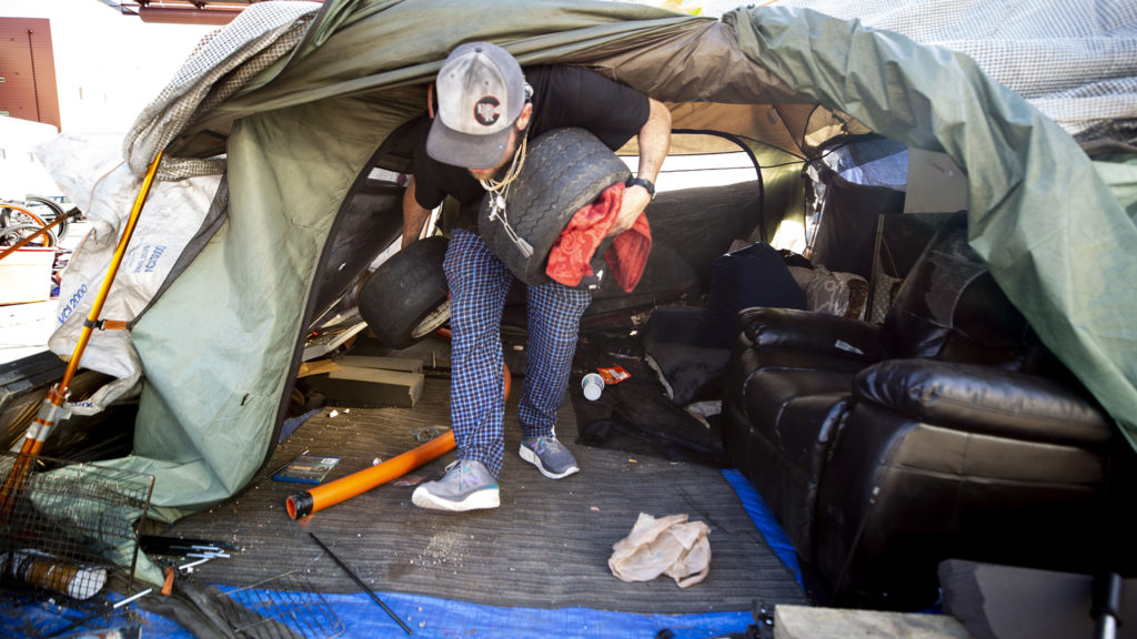 Dustin Fitzpatrick packs up his home in Five Points at the orders of Denver Police. May 7, 2020. (Kevin J. Beaty/Denverite)