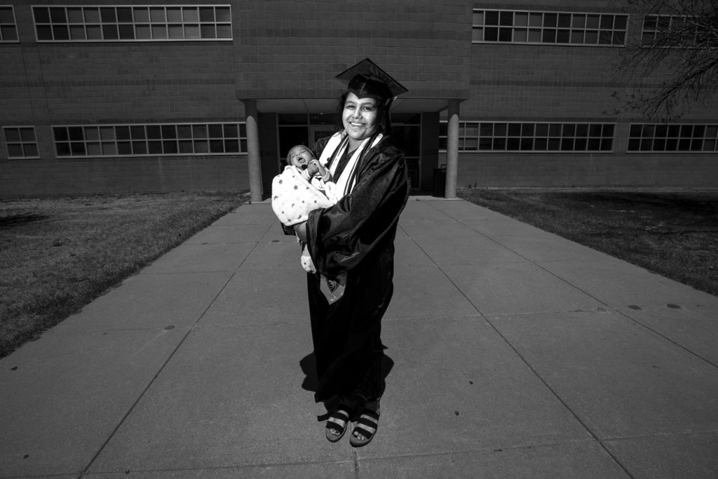 Alondra Hernandez and her son, Mateo. A graduation celebration at Martin Luther King Jr. Early College, Green Valley Ranch. May 8, 2020. (Kevin J. Beaty/Denverite)