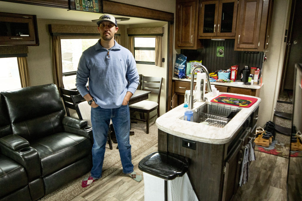 Bailey Queen in the RV trailer where he's been living in front of his parent's house in Thornton. May 11, 2020. (Kevin J. Beaty/Denverite)
