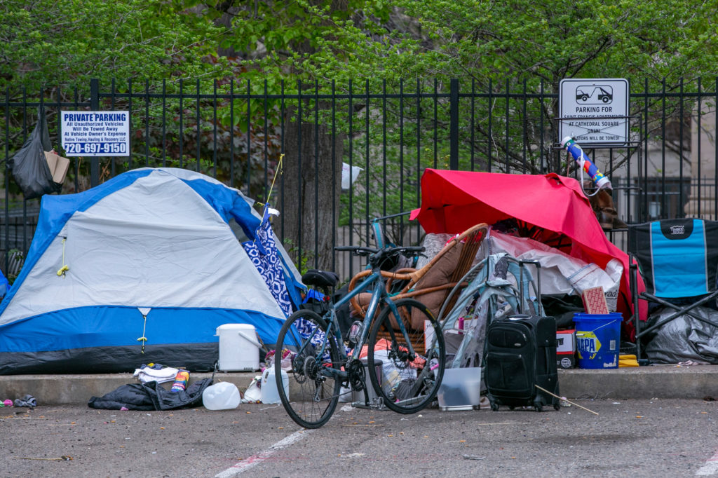 Part of homeless encampment that has grown on Washington Street in Denver next to St. John's Cathedral, and in the parking lot south of Argonaut Liquor, Monday, April 11, 2020.