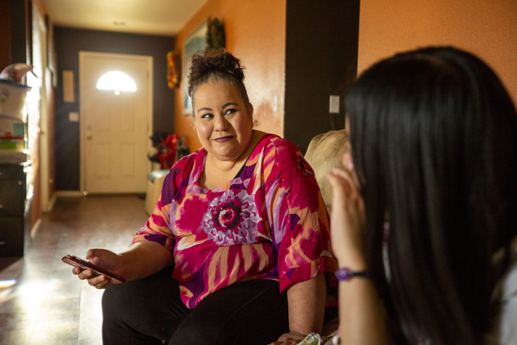 Dina Puente and her daughter, Allison, in their Montbello home. May 13, 2020. (Kevin J. Beaty/Denverite)