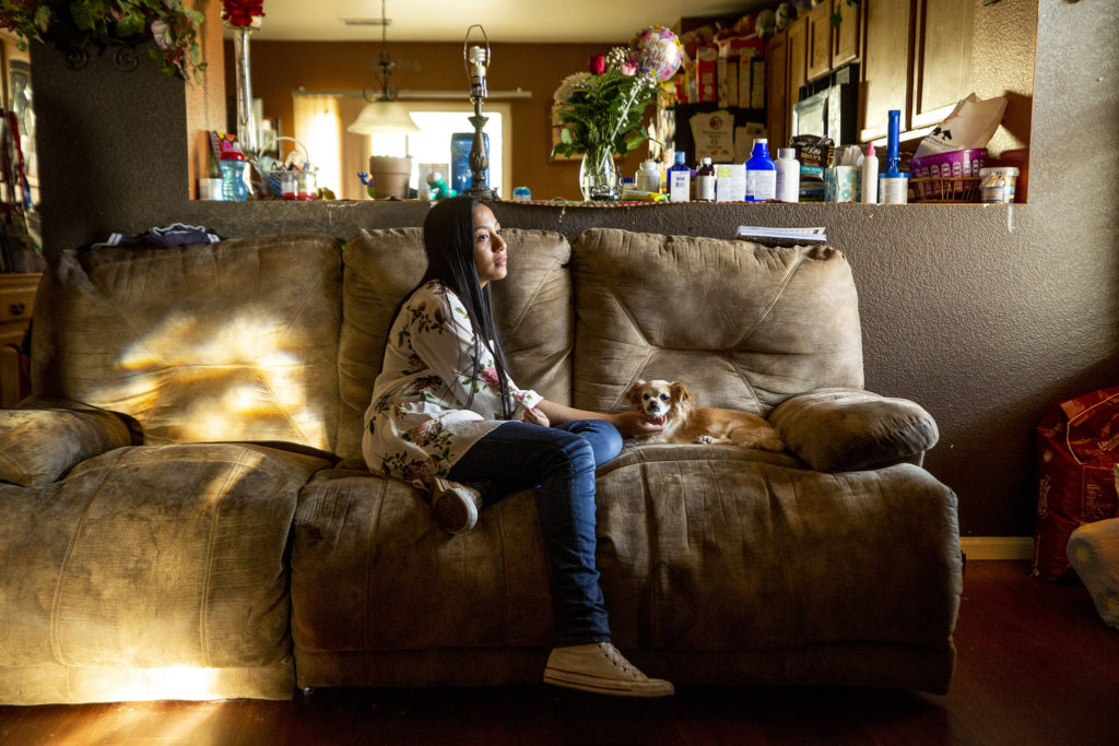 Allison Puente and Chiquita, one of the family dogs. May 13, 2020. (Kevin J. Beaty/Denverite)