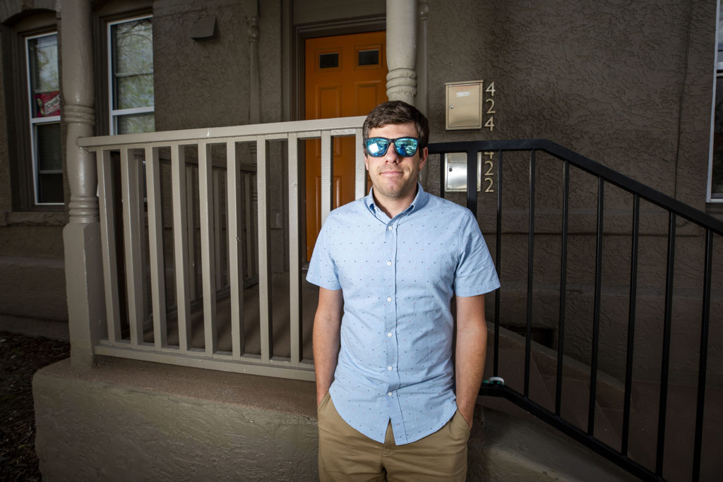 Joe Szuszwalak stands in front of his Five Points apartment. May 13, 2020. (Kevin J. Beaty/Denverite)