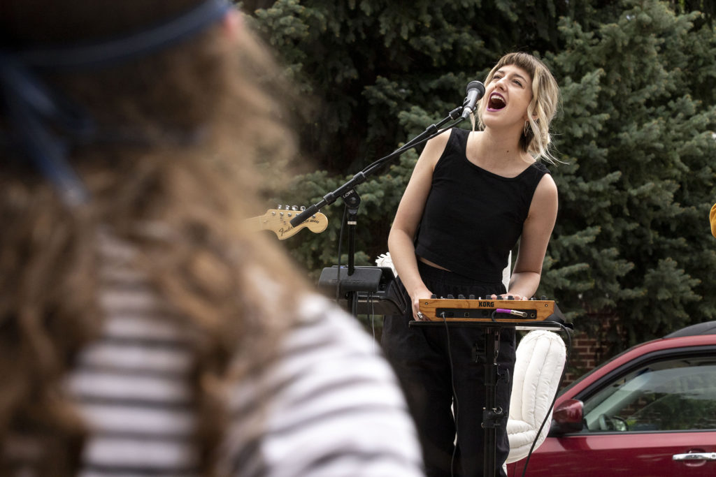 Wildermiss frontwoman Emma Cole sings during a two-song show for Lucy Kiefer at her home in Virginia Village. May 15, 2020. (Kevin J. Beaty/Denverite)