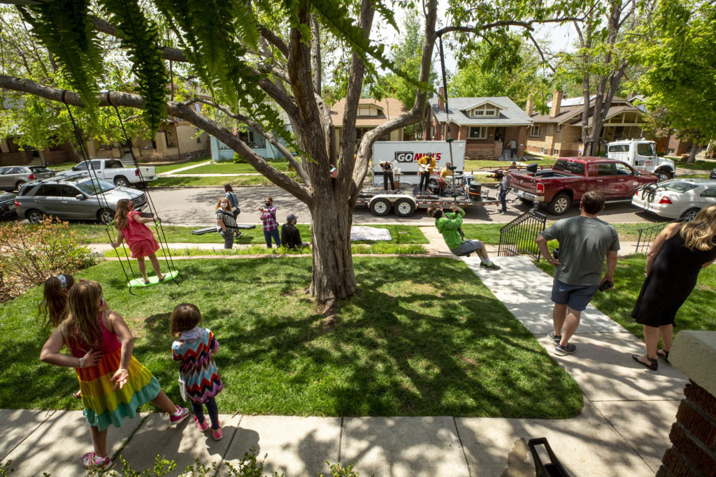 Kids play at Jessica and Jason Dewees' home as Wildermiss rocks out in the street. May 15, 2020. (Kevin J. Beaty/Denverite)