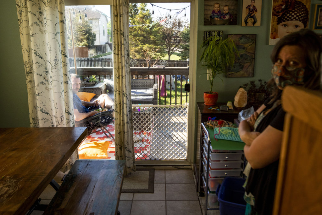 Sara Walsh stands inside her Thornton home as her son, Bailey Queen, eats inside. May 18. 2020. (Kevin J. Beaty/Denverite)