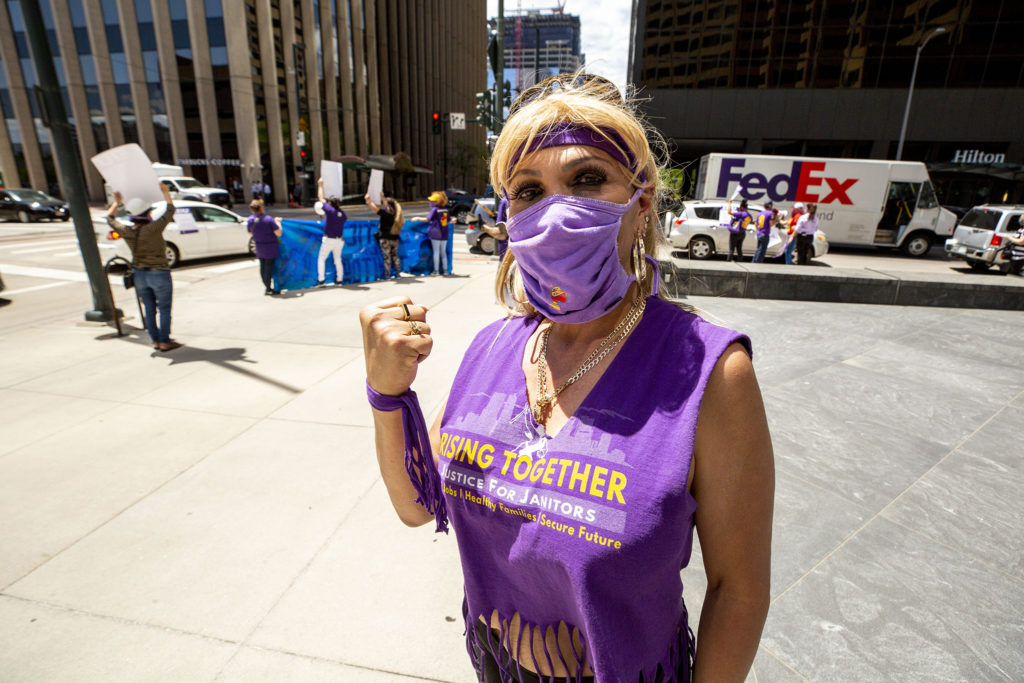 Jennifer Menjivar stands outside of 1801 California Street as Service Employees International Union janitors protest for better safety measures and higher wages. May 19, 2020. (Kevin J. Beaty/Denverite)