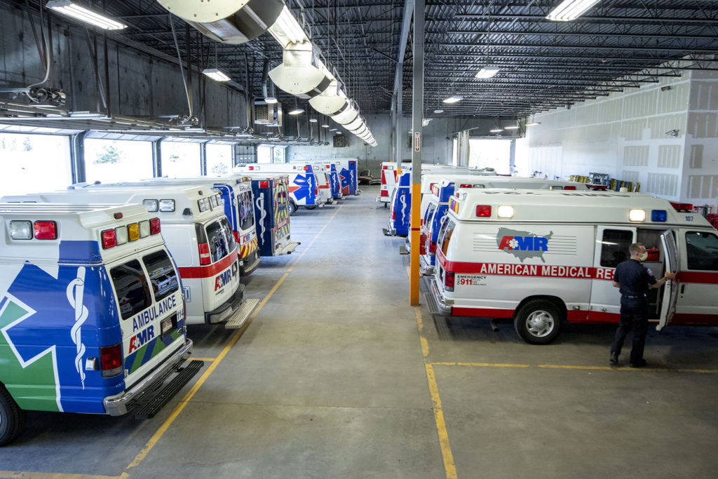 Bailey Queen preps his ambulance for a 10-hour shift at American Medical Response's headquarters in Arvada. May 22, 2020. (Kevin J. Beaty/Denverite)