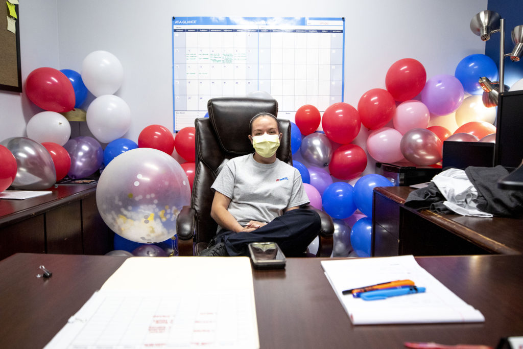 Liz Steadman in her office at American Medical Response's Arvada headquarters, which her employees filled recently with balloons. May 22, 2020. (Kevin J. Beaty/Denverite)