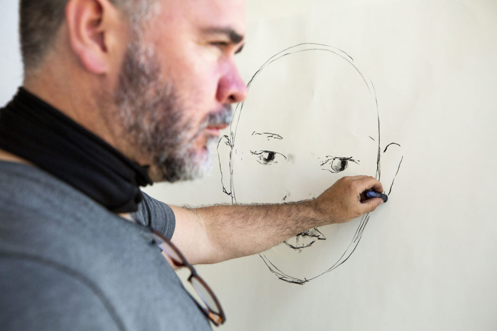 Michael Dowling draws a portrait of Donna Bryson at the Leon Gallery. May 26, 2020. (Kevin J. Beaty/Denverite)