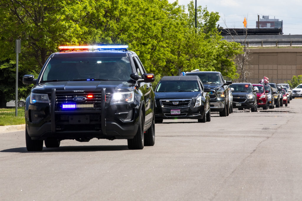 Police lead a procession of cars accompanying Pastor Terrance Hughes home after three months in treatment and recovering from COVID-19. May 27, 2020. (Kevin J. Beaty/Denverite)