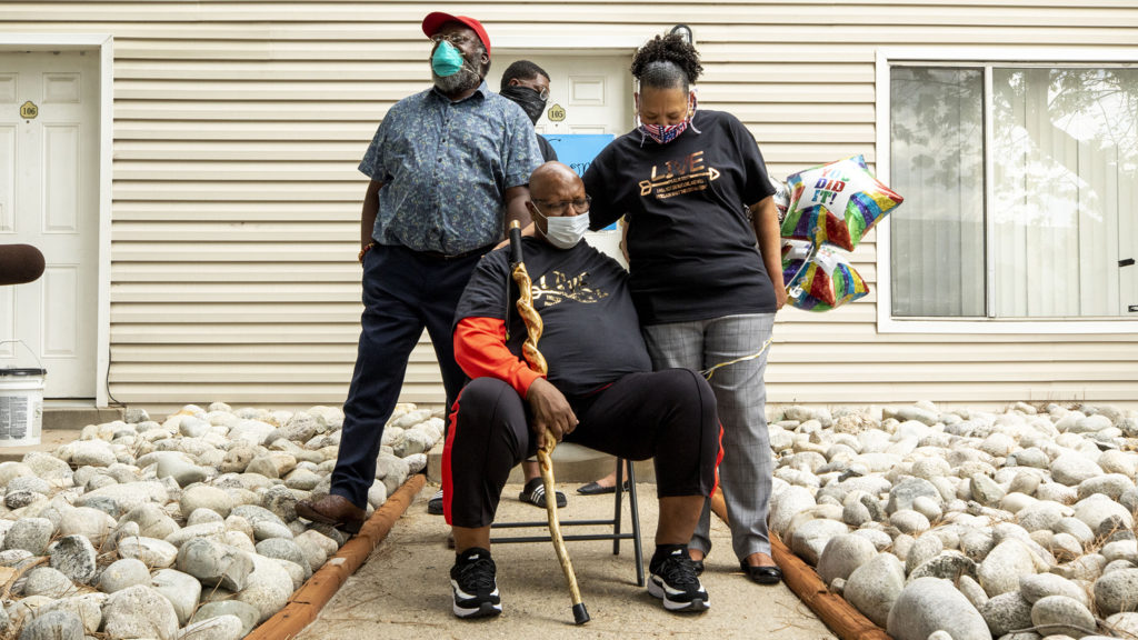 Pastor Terrance Hughes prays with his wife, Rachel, after three months in treatment and recovering from COVID-19. May 27, 2020. (Kevin J. Beaty/Denverite)