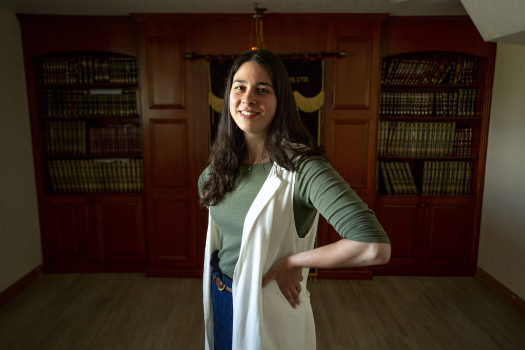 Rivka Brackman stands in the basement at Chabad of Northwest Metro Denver, the Westminster synagogue where she grew up. May 27, 2020. (Kevin J. Beaty/Denverite)