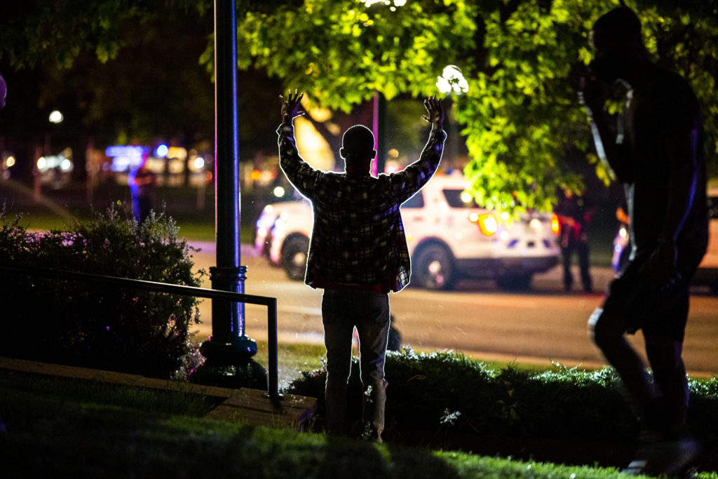 A man holds up his hands as protesters by the Capitol react to the killing of George Floyd. May 28, 2020. (Kevin J. Beaty/Denverite)