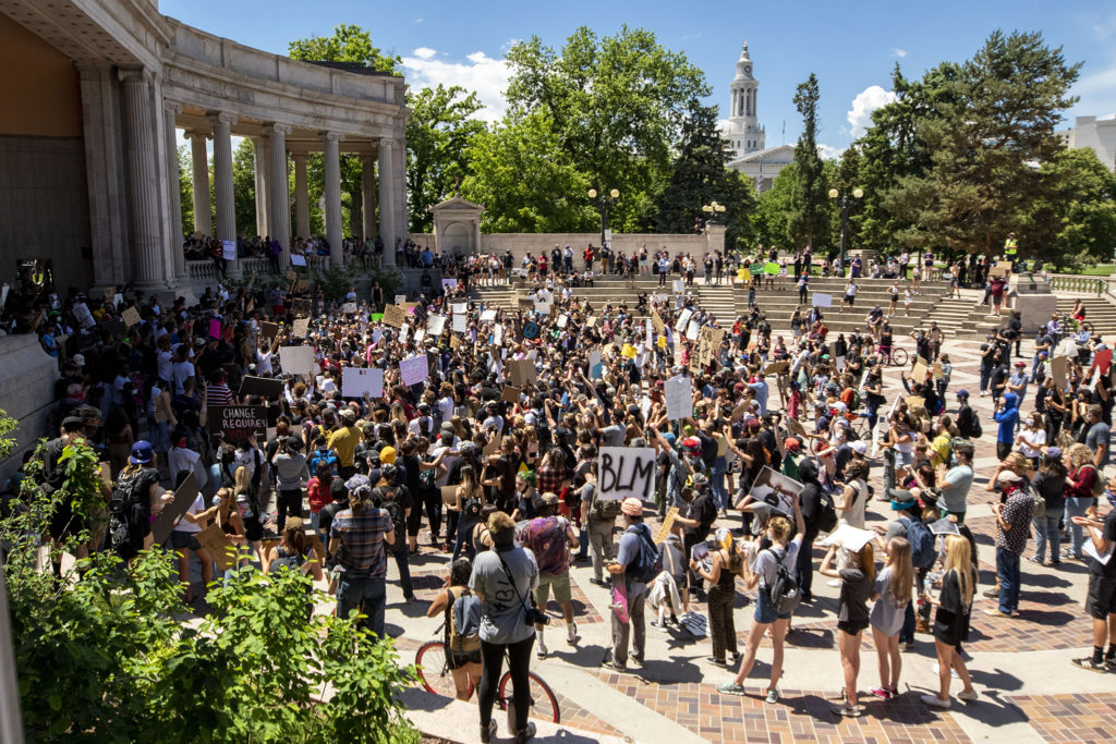 Protesters gather in the Greek Amphitheatre in Civic Center Park in a rally against police brutality and calling on the police involved in George Floyd's death to be charged with murder. (Kevin J. Beaty/Denverite)