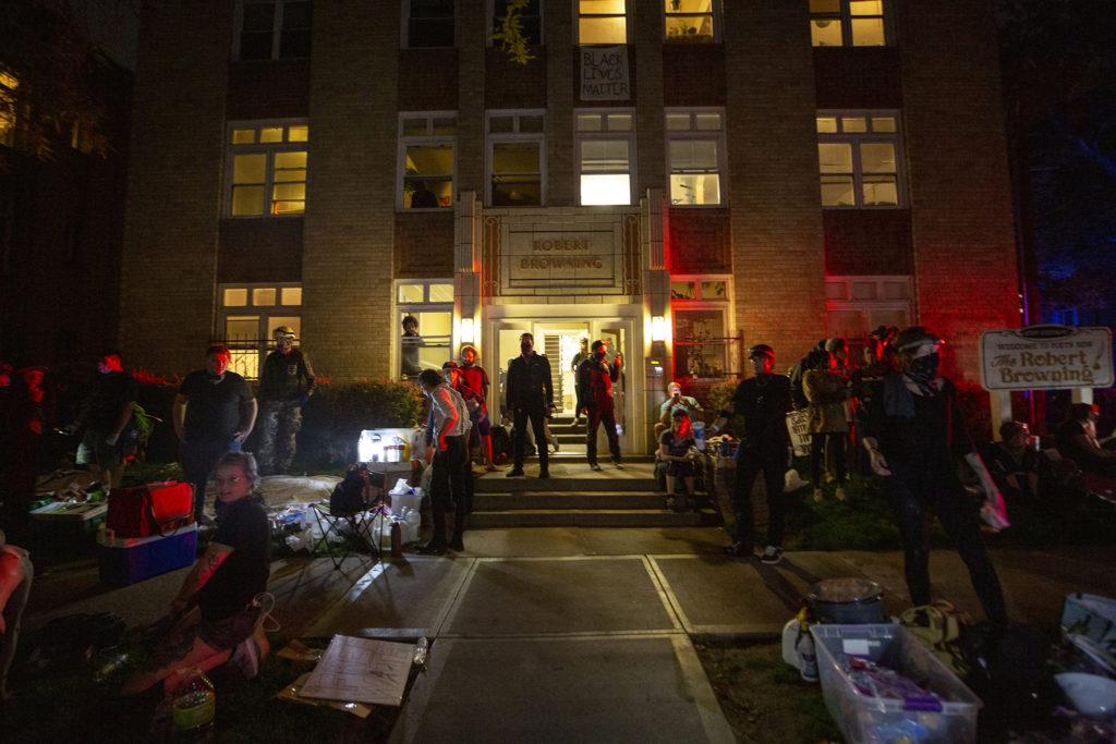 The scene on Poet's Row, outside Dorian Gray's apartment, as dusk fell. May 30, 2020. (Kevin J. Beaty/Denverite)