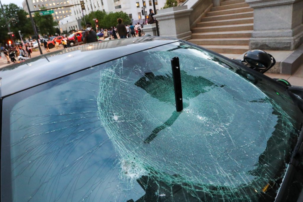 A car's window is smashed outside the state Capitol during demonstrations in downtown Denver against the death of George Floyd on May 28, 2020. (Hart Van Denburg/CPR News)