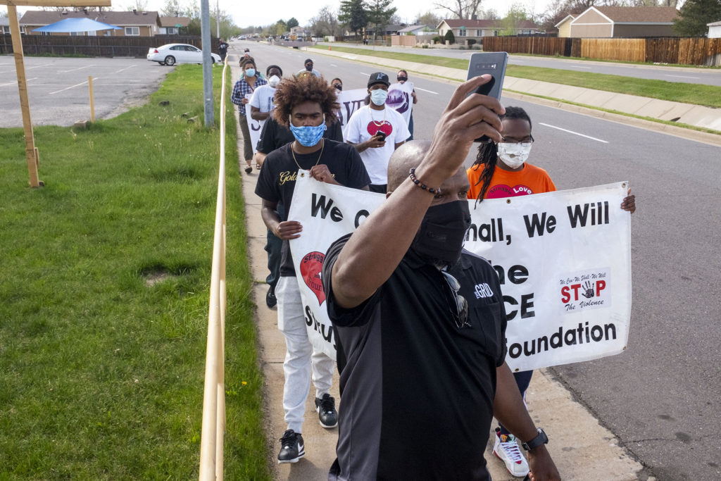 Stephon Cummings leads a march against youth violence in Montbello. May 5, 2020. (Kevin J. Beaty/Denverite)